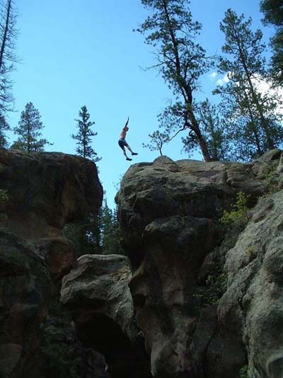 Jumping between some rocks, near The Box, East Fork of the Jemez River.